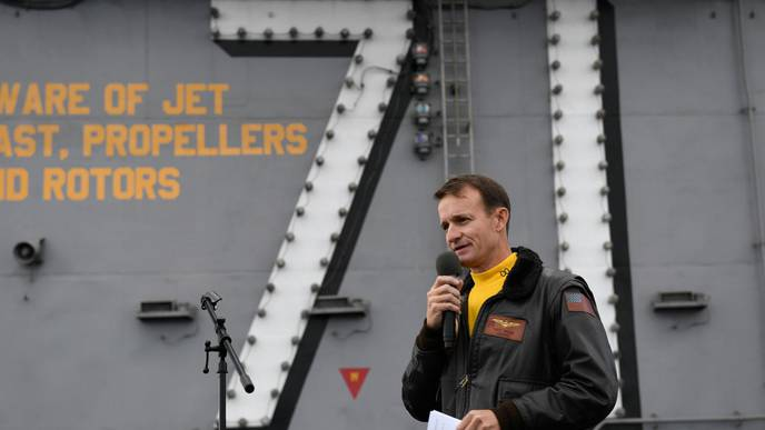 Navy Captain Removed from Carrier Tests Positive for COVID-19